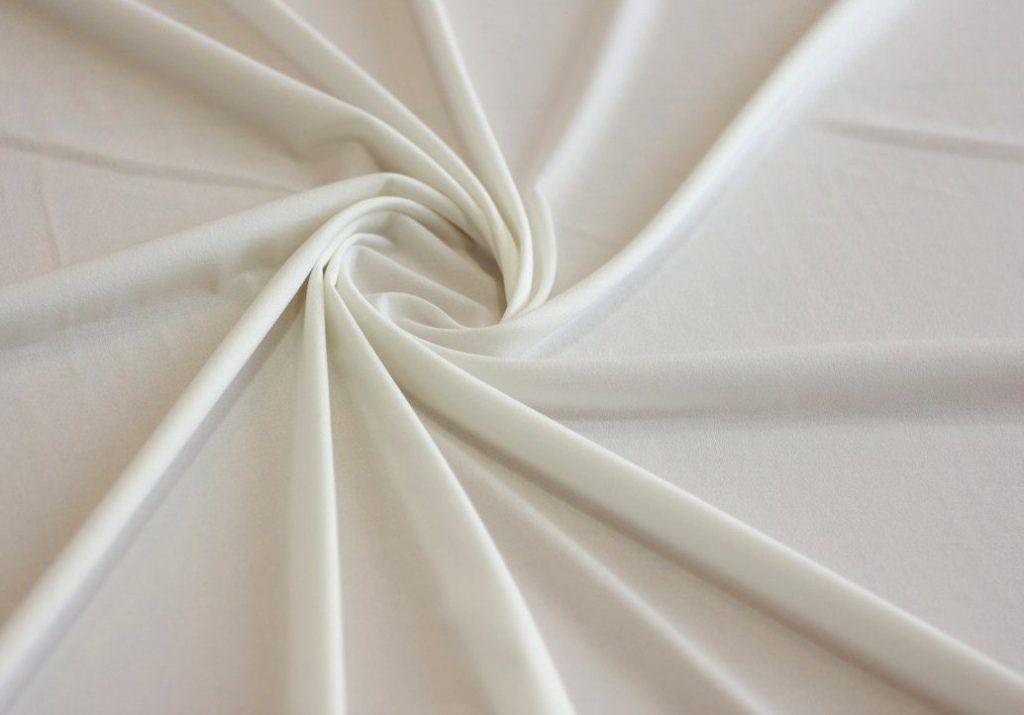 Ткань трикотаж масло молочный